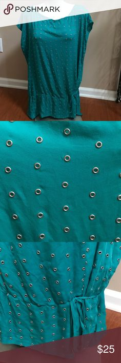 Turquoise stud detail top Unfortunately, I do not know/remember the brand of this top. There is no brand label tag inside the top. This top is turquoise with little stud detailing all over. These open studs do have openings, so I would recommend to wear a top underneath. Due to the studding detail, this top is heavier than your average top. It is a bit oversized, although it is size petite. Can fit a small to medium. Ties along the bottom. Tops Tunics