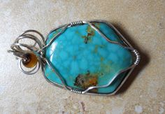 Turquoise cab pendant wired wrapped in Sterling silver with agate bead accent by RaptFyre on Etsy
