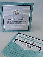 turqoise and white wedding invitation and wedding stationery with crystal buckle and 1950 theme High society