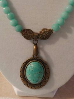 Turquoise pendant with Jade stones with accents to match the setting