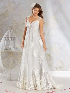 An elegant a-line dress in empire style with a decorated lace ...