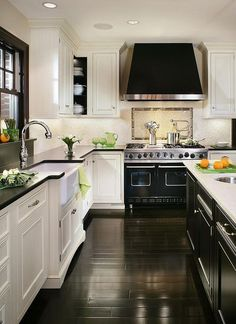 Luxury Black & White Kitchen with Black Wood Floors | Kitchen and Dining  | White Kitchens, Kitchens and Black
