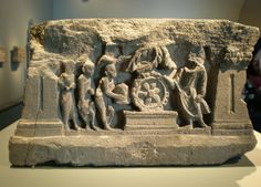 Part of a base or superstructure of a small stupa. A scene from the life of the Buddha, from Gandhara (c 100-300). The Asian Art Museum San Francisco.