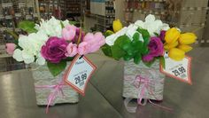 White hydrangeas, pink spray roses, and tulips! Laced container cute.