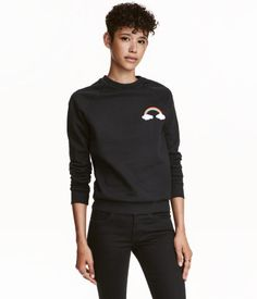 Black. Soft sweatshirt with a motif at front and ribbing at neckline, cuffs, and hem. Soft, brushed inside.