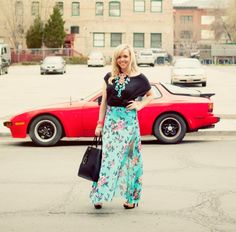 Red vintage car is the best backdrop for this fashion photo.