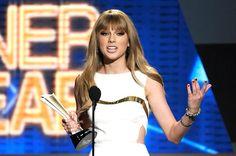 Taylor Swift - blunt, slightly layered bangs, long, slightly layered long straight hair
