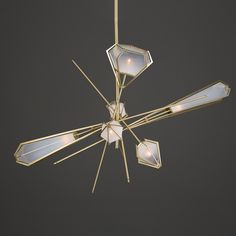 The inspiration for the elegant Harlow Large Chandelier comes from modern jewelry design.