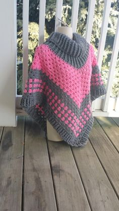 Hot Off My Hook! Project: Cowl Neck Poncho Started: 14 Jan 2016 Completed: 16 Jan 2016 Model: Madge the Mannequin Crochet Hook(s): 7mm, Cowl portion, K, Granny Stitch portion Yarn: Bernat Super Value, RedHeart Super Saver Color(s): Alpine Snow, True Grey, Perfect Pink Pattern Source: Simply Crochet Magazine, Issue No. 25 (Hard Copy) Pattern Designed By: Simone Francis Notes: This is my 68th Cowl-Neck Poncho!