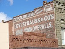 photo of an advertising sign for Levi Strauss & Co. painted on a brick wall in Woodland, California