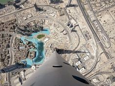 The view from the skyscraper BurjKhalifa (not a plane) in Dubai. The height of building is 828 m (163 floors) or 2,716.5 feet.