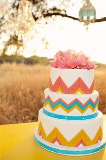 Colorful and creative wedding cake with zig zag print and pink flowers