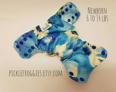 Newborn All In one diaper with a birdseye cotton interior.  Additional absorbency in a tongue style soaker with hemp