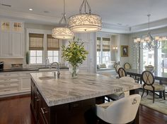 Classic Kitchen ~ I Love the Window Seat in the Dining Area and the Light Fixtures Over the Center Island are Gorgeous!!!
