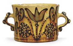 A STAFFORDSHIRE SLIPWARE TWO-HANDLED CYLINDRICAL CUP