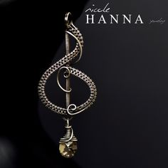 This beautiful classic wire wrapped Treble Clef pendant is perfect for any music lover. Featuring a stunning pale golden Swarovski drop, this Treble Clef was wrapped in an elegant design, over 2 inches in length, with silver-filled wire oxidized for an antique finish. Pendant will arrive with an ...