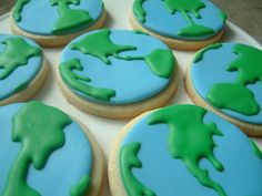 Globe Earth Space Cookies - no fail cookie with mmf base. details in modified royal. cookies made to go with Buzz Lightyear Space cake as favors. Packaged with the rocket cookie.