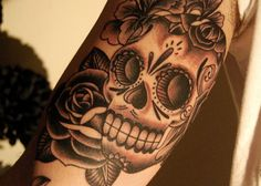 The shading on this sugar skull tattoo is sick.