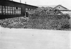 View of a large pile of victims' shoes piled up outside barracks in the Dachau concentration camp, May 1, 1945