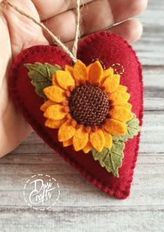 Red sunflower ornament for fall decorations Hedgehog Craft, Red Sunflowers, Fabric Flower Brooch, Wool Applique Patterns, Wool Embroidery, Felt Christmas Ornaments, Heart Ornament, Wool Felt, Felted Wool