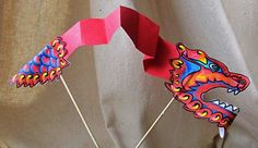 How to make a Paper Dragon from paper and thin lolly sticks