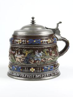 """1653 German (Creussen) Tankard at the Victoria and Albert Museum, London - From the curators' comments: """"Many types of beer mug were made in Germany in the 17th century. Perhaps the most decorative were the dark-red stoneware tankards made at Creussen in Saxony. For these the technique of enamel decoration in bright colours was used, which is usually associated with glass. As luxury products made for a local market, they were not exported to England."""""""