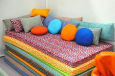 Fabric covered foam pads stacked for sofa in play room and can be pulled apart for tumbling, sleepovers, etc