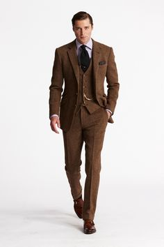 Crisp and elegant. I like the contrast in textures and colour tones between a plain silk black tie and a soft, rusty brown tweed.
