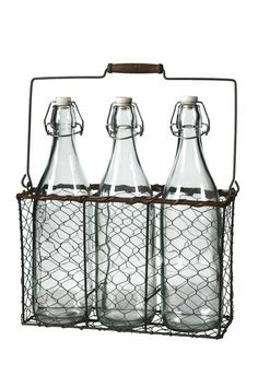 Glass Bottles in Wire Basket.