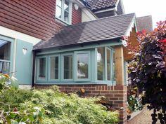 Green RAL coloured timber look alike Upvc Windows and Doors