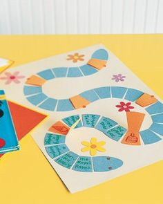 For each book your child reads, she earns a segment of the bookworm; every fourth or fifth segment hides the promise of a prize, such as an ice cream cone or stickers. Glue construction-paper segments onto paper or poster board (cut a worm pattern from plain paper first); for prize segments, cut segments from folded paper, glue down the back, then open and draw a picture of the prize inside. Tack down flap with a sticker.