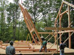 Raising the second 'bent' on the Douglas fir timber frame. Frame raised near Mountain City, GA.
