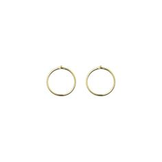 The Lines collection is built around the idea of an elegant simplicity, and the Small Circle earrings are very graphic, light and have a natural elegance to them. They are made of gold plated sterling silver.