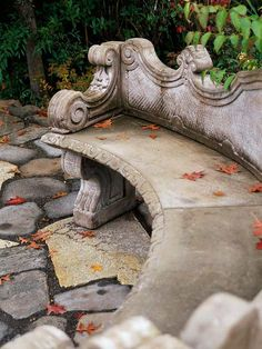 Garden Tour: The Everything Garden-An ornate stone bench provides a perch from which to enjoy the garden.