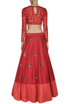 This set features a red lehenga in silk base with pearl and sequins flower motifs scattered all over and a lighter red silk broad border. It has a can-can under
