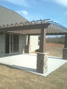 I like the brick around the pillars.....and patio no deck. #deckbuildingconcretepatios #deckbuildingtips