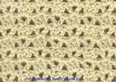 This free crochet afghan pattern is easy to make and can be done quickly. Using the v-stitch and shell stitch together makes this crochet afghan just lovely.