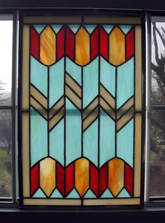 Tulip Geometric Stained Glass Panel. $125.00, via Etsy.