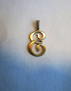 $9.99 Vintage Cursive Initial E Sterling Pendant by feathersoup on Etsy