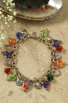The beads on this cloisonne bracelet are created using an ancient technique. Wires are applied to each bead, then the sections are filled in with an vitreous enamel. When the process is finished, you