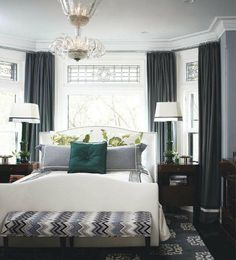 Luscious style: Bedrooms; bed in front of bay window