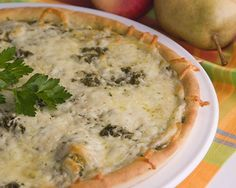 Cheesy Pesto Bread A pesto topped bread crust with two cheeses added makes this a delicious appetizer. #rhodesbread