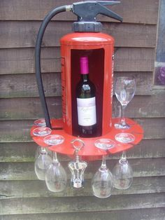 Wine Holder - Folksy £60......STEVE! QUICK! THE HOUSE IS ON FIRE.. WHERE'S THE EXTINGUISHER!!!????
