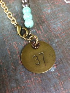 """Brass """"37"""" Medal Necklace with Pewter and Turquoise Beads   on Etsy, $38.00"""