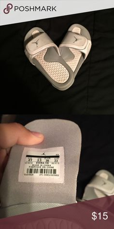 Jordan slip on White and gray Jordan slip on sandals. Youth size 4 but can fit I women's 5. Lightly used but can easily be cleaned! Jordan Shoes Sandals