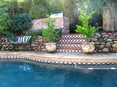 Love the Spanish tile around the pool and on the steps