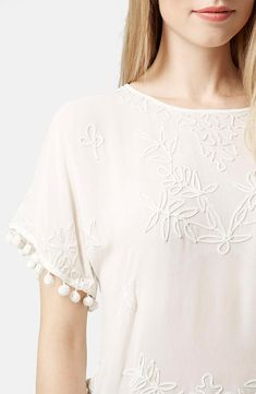 Obsessed with this cute floral textured Topshop tee.