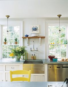 With modern amenities and vintage touches, this kitchen has old pendant light fixtures, no-fuss zinc countertops, and chairs rescued from a friend's basement and painted a sunshiny yellow. Designed by Ruthie Sommers. More: 101 Easy Home Makeover Ideas   - HouseBeautiful.com