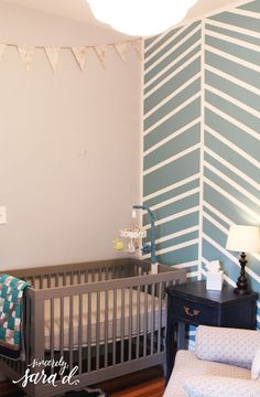 Love this herringbone-inspired painted wall - includes tutorial!