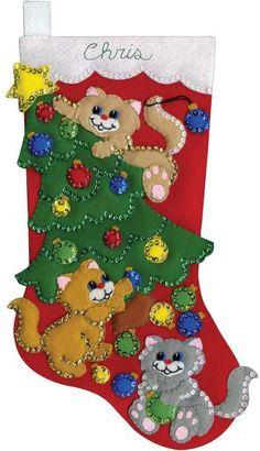 Design Works Decorating Kittens Christmas Stocking - Felt Applique Kit. Felt Applique kit featuring a Christmas Stocking with a Christmas tree and cats. This fe